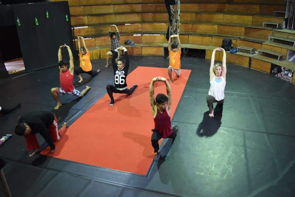 Stretching during dance training with Mylena at Phare Circus
