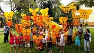Young students display masks made for the Giant Puppet Parade , Siem Reap