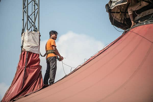 Phare Circus technical manager Sopheak Sam on top of the big top