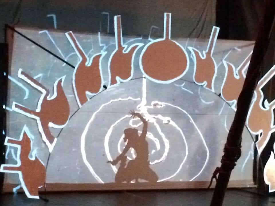 Phare Ponleu Selpak live performance - traditional dancer performing behind screen of live painting video mapping