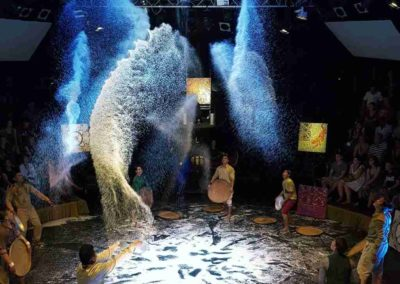 """Phare Circus live show - """"White Gold"""" - impressive design made by artists throwing rice in the air"""