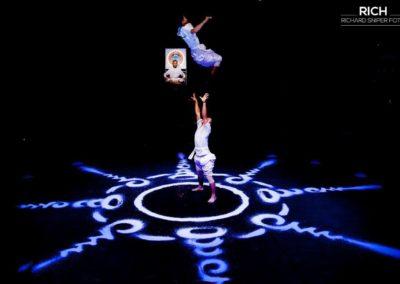 "Phare Circus live show ""White Gold"" - hand-to-hand acrobatics over Buddhist mandala design created with rice"